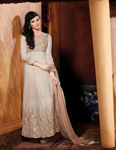 Stimulating Cream Embroidered Long Suit  Design No :- 18553 Product :- Unstitched Salwar Kameez Size :- Max 40 Fabric :- Inner Jacquard, Net Work :- Resham, Jari, Embroidery Stitching Charges :- र 400 Price :- र 6145  For Sales Queries :- sales@manjaree.in OR call on 0261-3131669  For More Information :- http://manjaree.in/  Follow Our Blog :- http://manjareefashion.blogspot.in/