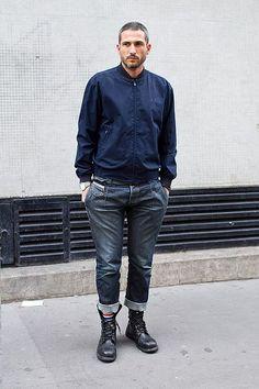 Shop this look on Lookastic:  http://lookastic.com/men/looks/navy-bomber-jacket-navy-jeans-black-leather-boots/7761  — Navy Bomber Jacket  — Navy Jeans  — Black Leather Boots