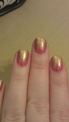 Extending yesterdays manicure (matte sparkle pink) with sponged gold glitter tips.