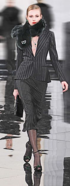 Ralph Lauren -- I love the sleek look of this suit, but with a silk camisole or something beneath the jacket, of course.