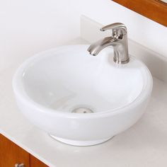 Give your bathroom a chic, modern upgrade with this round Elite vessel sink and faucet set. Finished in a sleek white color, this two-piece set features a brushed nickel, single-handle faucet for convenience.
