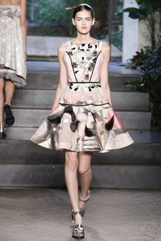 Inspired by the sculptures of artist Kathy Ruttenberg, Antonio Marras charmed with dresses and skirts that became the canvas for a hand-painted finish.