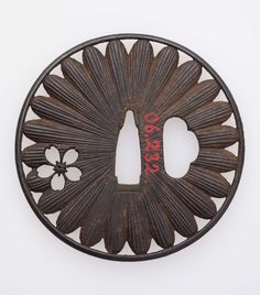 Tsuba with design of chrysanthemum and cherry | Museum of Fine Arts, Boston