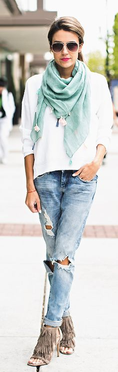 Street Style, April 2015: Christine Andrew is wearing a J Brand white sweater with a Teal tassel scarf, distressed Shopbop jeans and fringed Steve Madden heels