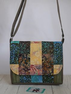 Items similar to Patchwork crossbody messenger bag made to order from cotton batik fabrics in your choice of colour combination on Etsy Crossbody Messenger Bag, Satchel, Tote Bag, Shades Of Turquoise, Shades Of Purple, Green To Blue, Patchwork Bags, Bag Making, Woodland