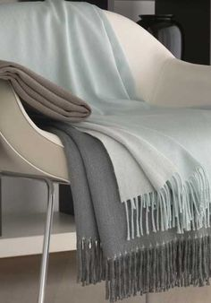 As Fall approaches we all feel more inclined to curl up with a warm throw - and these are just the right throws! The Leida Throw is Cashmere/Silk/Australian Marino Lambswool Available in 4 colors: colors not shown- ecru, ivory.