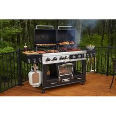 The serious grill master would never be caught without the Pit Boss Memphis Ultimate LP Gas/Charcoal Grill with Smoker . Clean Grill, Bbq Grill, Grilling, Door Grill, Grill Area, Gas And Charcoal Grill, Charcoal Smoker, Best Gas Grills, Grill Station