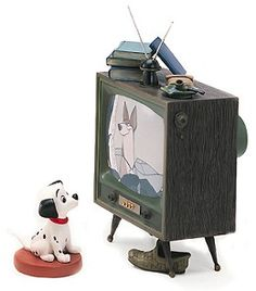 WDCC Disney Classics 101 Dalmatian Lucky And Television #WDCCDisneyClassics #Art. 2 Piece Set: TV is separate resin piece with decal of Lucky's favorite TV personality, Thunderbolt. Book, Pipe, Ashtray and Tobacco Pouch (on top of TV): Metal. Early Dealer Display.