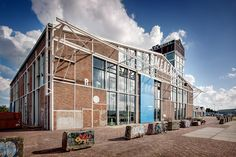 GROUP A transforms the historic remnant of smederij NDSM in amsterdam - designboom | architecture