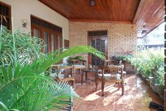 Homeowner: Mano Dharmalingam  Location: Sri Lanka  Why we love it: If you want to create a tropical vibe, just add some potted green palms to your porch or patio.  RELATED: 43 Porches and Patios We'd Love to Relax On      - CountryLiving.com