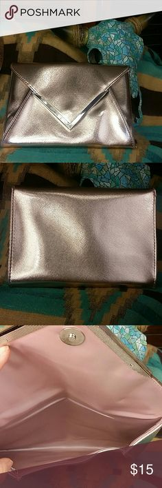 """NWOT Metalic Pink Envelope Clutch NWOT Pretty Pale Pink metallic clutch. Magnetic closer. Pink satin lined inside. 7"""" tall, 9.5"""" across Bags Clutches & Wristlets"""
