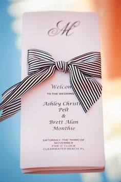 Black and White Striped Ribbons add a glam element to simple paper goods | Dramatic and Glamorous Wedding on the Water in Blue, Black, and White