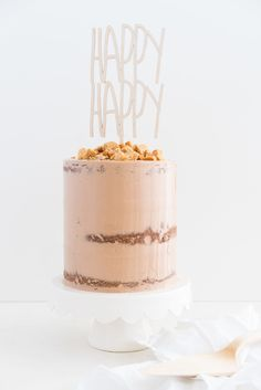 Peanut Butter Cake with Dark Chocolate Swiss Meringue Buttercream and Peanut Butter Crunch #cake #peanut butter