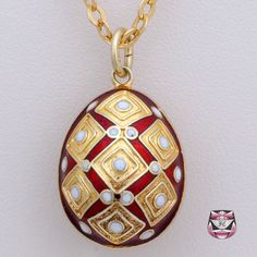 Victorian Style Enamel Egg Set 14K Necklace. This wonderful piece srves as a locket in it's full egg shape, just imagine what you could carry inside.