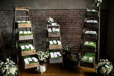 unique escort card display // DePaola there are those stand things again! Industrial Wedding, Rustic Wedding, Wedding Reception, Wedding Bells, Seating Chart Wedding, Seating Charts, Flower Decorations, Wedding Decorations, Liberty Warehouse