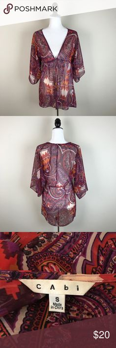 """CAbi Paisley Sheer Kimono Tie Wrap Tunic Blouse Cute sheer paisley patterned kimono top that ties in he front. Gently worn with no flaws. 100% polyester.  Measurements laying flat (without stretching)— Armpit to armpit: 16.5"""" Length (shoulder to hem): 30"""" CAbi Tops"""