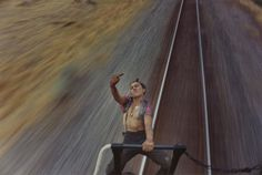 """Photography from Mike Brodie. """" Born 1985 in Arizona, Mike Brodie first began photographing in 2004 when he was given a Polaroid camera. Working under the moniker, The Polaroid Kidd, Brodie spent the. Hugh Holland, Vivian Maier, Paris Photos, Photos Du, Shows In Nyc, By Train, Train Tracks, Photo Series, Train Rides"""