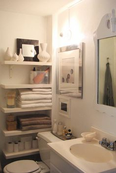 bathroom storage -- beautiful solution for very small space.
