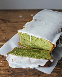 Green tea powder gives this moist pound cake a pretty green color, and the light toasty flavor pairs well with a sweet almond glaze.