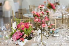 Blossoms in place of candles in a candelabra...neat idea!