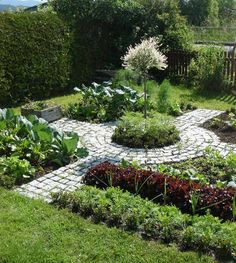 kitchen garden with pavers in the shape of a Celtic cross - Pinterest via Atticmag