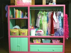 Dress up station we made our 3 year old for her birthday. Made from an old entertainment center. It turned out perfect! on the side is also a full length mirror and the other side has hooks, a bow hanger and a dry erase board....so fun!