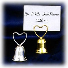 "Bell Placecard Holder with Heart Shaped Clip (Set of 12) | Nuptial Knick Knacks    Measures: 1 1/4"" X 2 3/8""  Available in Silver Plated (3860) & Gold Plated (3861)  Sold in Set of 12    Yes, The Bell Does Ring!"