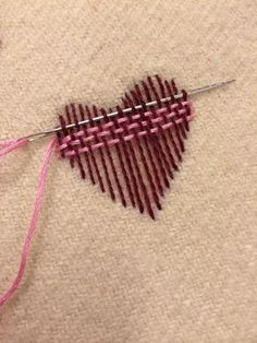 """Surface darning - nice illstration. I might switch to a blunt tapestry needle for the back-and-forth weaving, after laying down the weft with a pointed needle. """"Wear Your Heart on Your Sleeve"""" (2014)"""