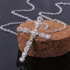 https://www.milestonekeepsakes.com/collections/religious-collection/products/jecksion-new-luxury-women-silver-crystal-rhinestone-cross-necklace-statement-chain-movie-jewelry-lassic-male-pendant-necklace-2