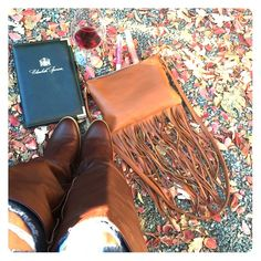 Fringe brown purse Only worn once. Super chic to have for fall & winter. It can hold iPhone 6 & basic necessities like lipstick & lip gloss. Great condition inside & out. Please no trading or pp. I give bundle discounts. Tag me if you have any questions. Bags