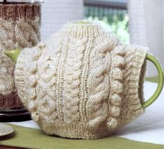 Aran Teapot Sweater by Sarah Golder    This is beautiful and tea cozies do keep the pot hot!