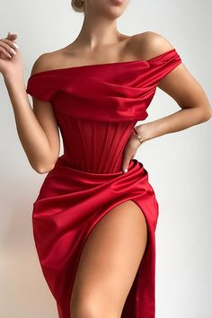 'Dalo' is our super sexy and stylish one shoulder drape creation with a touch of elegance in a seasonal wine tone. Crafted from our ultra luxe duchess satin featuring our special boned corsetry that gives ultimate support for a sculpted fit. The internal layer is made from our special stretch power mesh that sculpts the figure from within and acts like shape wear but is built into the garment. It is boned through the front and back and features additional 'side boob' boning to create the… Trendy Dresses, Club Dresses, Ball Dresses, Satin Dresses, Evening Dresses, Fashion Dresses, Ball Gowns, Corset Dresses, Elegant Red Dresses