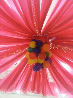 Ceiling using plastic tableclothes, a hulahoop and a balloon chandelier