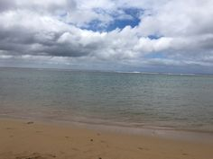 clean beach, clear water, blue skies