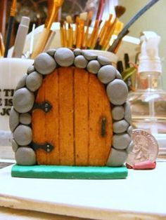 "fairy door - made from polymer clay - I like the details of the hinges, boards, handle, but what I really love are the ""rocks"" the door is set in - nice job! +++++++++++++++++ for Franni by coltpixy, via Flickr #fairy #garden #door"