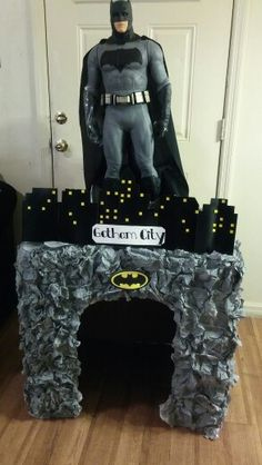 I made this cool Batcave for my son's batman vs superman birthday party & it was a hit. All you need is a huge box, hot glue, glue gun, brown paper bag paper & crumble it to get the rough look (I used 2 packs of notebook paper it makes a lighter grey tone than with the Brown paper) & 3 cans of grey spray paint.