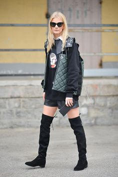 A guest poses before the Diesel Black Gold show during the Milan Fashion Week Fall/Winter 2016/17 on February 26 2016 in Milan Italy