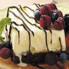 Summer Celebration Ice Cream Cake with brownies for the crust. This looks delicious!