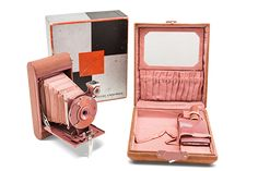 misha64:  Kodak Ensemble was made from 1929 - 1933. A Kodak Petite Camera whose case was made of suede  moire lining. It contained a mirror, changepocket, rouge, lipstick  powder compact.