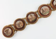 Lot 707, A 19th Century gold and micro mosaic 7 plaque bracelet with ruin scenes, est £200-300