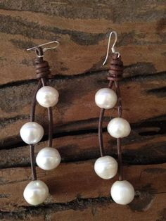 Beautiful pair of LARGE Freshwater pearl earrings! Pearls measure about 12-13mm. Each hand drilled and strung on antiqued leather to create these pretty earrings. Our pearl and leather jewelry is so versatile, you can enjoy wearing it at the beach, by the pool and with your favorite little black dress! Classic, timeless pearl jewelry that you will adore wearing for years and years to come!About Our Jewelry:Drawing inspiration from the southern charm and laid back lifestyle of Scenic Highway…