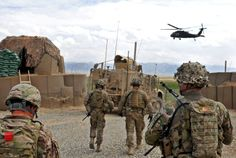 U.S. soldiers walk toward a UH-60 Black Hawk helicopter after a battlefield visitation on Observation Post English in Afghanistan's Logar province, April 18, 2014. U.S. Army photo by Capt. John Landry