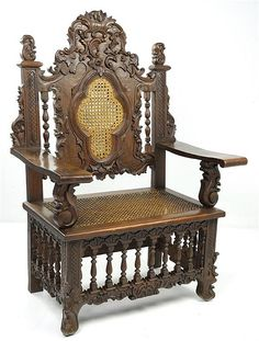 A RENAISSANCE REVIVAL VICTORIAN STYLE ARMCHAIR WITH CANE SEAT