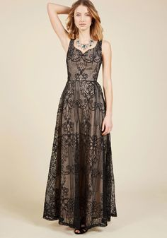 <p>For your most opulent occasions, rely on this black lace maxi dress to bestow all the elegance expected - and then some! Detailed with a sophisticated notched neckline, princess seams, and a full skirt highlighted by a beige underlay, this ModCloth-exclusive gown offers nothing but trustworthy luxury.</p>