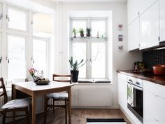 a bright and beautiful  home for sale in gothenburg  sweden    wouldn't mind having my  weekend breakfast in that cozy  kitchen corner