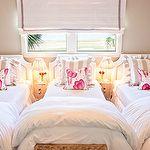 girl's rooms - gray walls white tufted twin nailhead trim headboards white gray striped pillows pink green floral pillows wicker storage baskets white roman shades gray ribbon trim