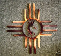 Sun Zia metal wall art w/ Kokopelli