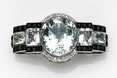 A blue topaz, aquamarine, diamond and onyx brooch, late 1930s - wow