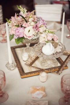 picture frames as the center on table...really like that.