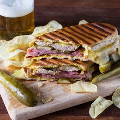 The Most Addictive Sandwich You'll Ever Eat. this classic Cuban sandwich, roast pork is layered with ham, Swiss cheese, pickles and yellow mustard before getting grilled to golden perfection. Kubanisches Sandwich, Cubano Sandwich, Soup And Sandwich, Panini Sandwiches, Chicken Sandwich, Sandwich Ideas, Cuban Recipes, Pork Recipes, Snacks